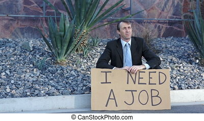 Businessman Sitting Need Job Sign - Businessman wearing a...