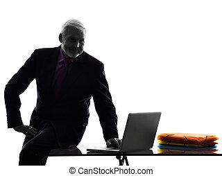 senior business man silhouette computing