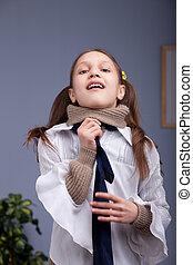 little girl wearing up a necktie like a man