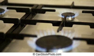 fire burning on a gas stove