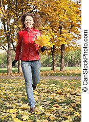 girl in the red jacket in the park in autumn