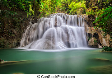 Landscspe of Waterfall with morening sunsise and jungle