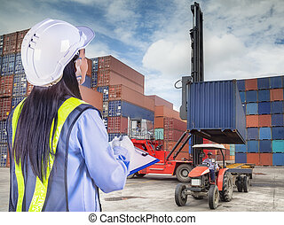 Crane lifter handling container box loading to truck in...