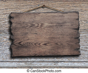 old wood plank or plate hanging on timber plank wall...