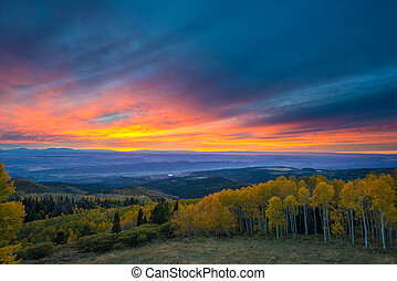 Colorful Dramatic Sunset Sky over the City of Moab Fall Colors