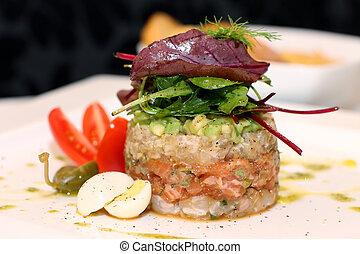 Salmon tartar - Tasty salmon tartar on white plate