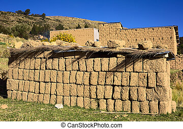 Pile of Adobe Brick at Lake Titicaca in Bolivia - Dried...