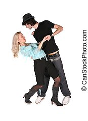 girl in cyan blouse dances with boy in black hat on white