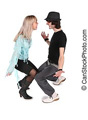 boy in black hat dances with girl in cyan blouse on white 2