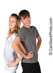 teenager couple stand back to back on white