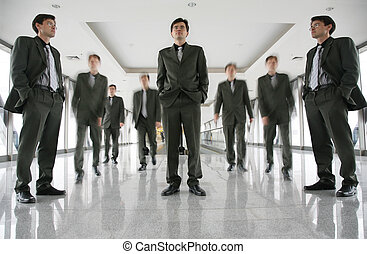 business people in corridor 3
