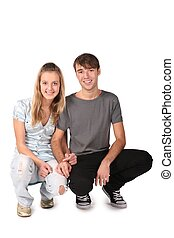 teenager couple sit on white 2