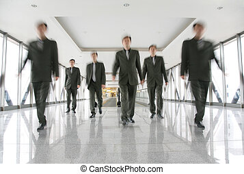 business people in corridor 2