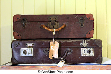 old suitcases - two very old Brown suitcases