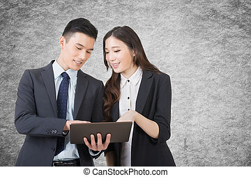 Business man and woman discuss - Business man and woman hold...
