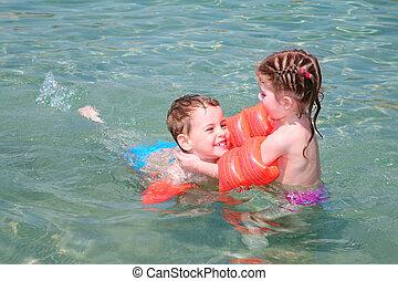 children in sea