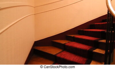 Climbing red stairs - Climbing up red stairs in a Paris...