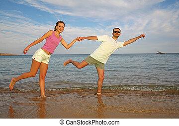 running couple on beach
