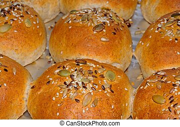 Wholemeal rolls with seeds.