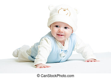 laughing baby boy weared funny hat lying on belly