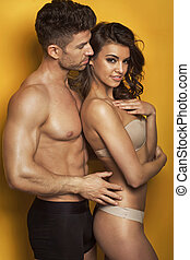 Portrait of the nude fit couple - Portrait of the young fit...