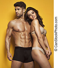 Muscular man with his gorgeous woman - Muscular man with his...