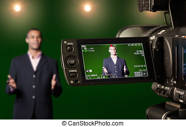 Presenter in the Viewfinder of a Digital Video Camera -...