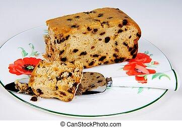 Sultana sponge cake. - Sultana sponge cake on a plate with a...