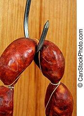 Chorizo sausage on a meat hook.