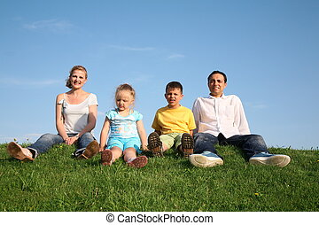 sitting family grass sky