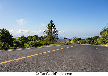 asphalt roadway with cloud blue sky background