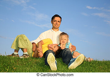 father with children on grass