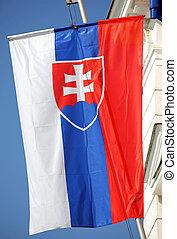 Slovak national flag on a mast