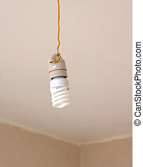 Electrical Energy saving light bulb in white chuck hanging...