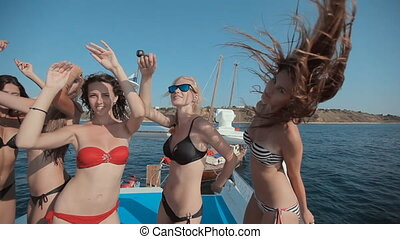 Girl in bikini on a yacht with the Russian flag and the red sails having fun