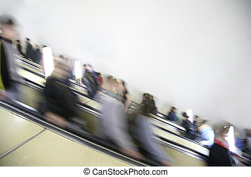 passengers on the escalator