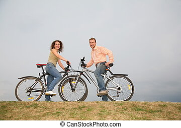 man and woman on the bicycles