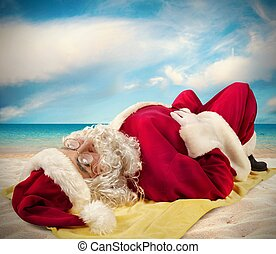 Santa claus sunbathing - Santa Claus lying sunbathing on a...