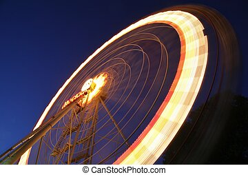 light trail of ferry wheel at night