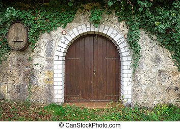 Round wooden gate - Round brown wooden gate with white stone...