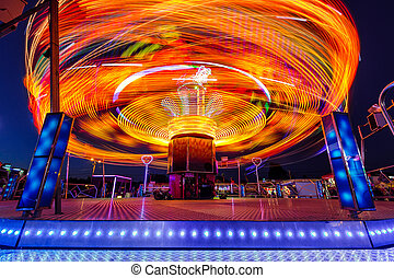 Carousels at night. Long time exposure