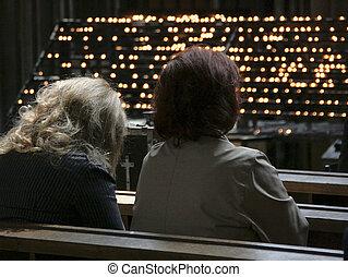 Prayer - Women praying in Catholic church