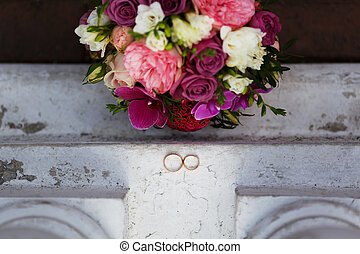 wedding rings on vintage surface