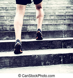 Jogger running on stairs sports training