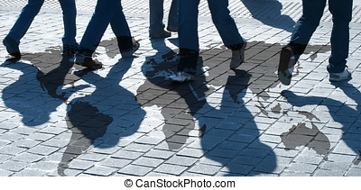 World travellers - View of silhouetted people walking over...