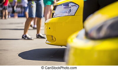 Yellow Cars At Exhibition - Close-up low-angle footage of...