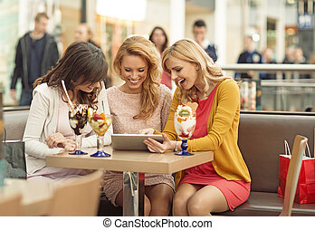 Three gladsome women in the coffee shop