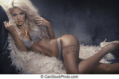 Portrait of the alluring woman wearing sexy lingerie -...