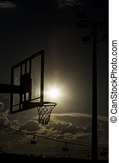 silhouette of a basketball hoop. - silhouette of a...