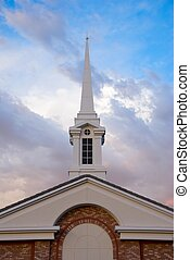 White Spire on Church Building with Dramatic Sky